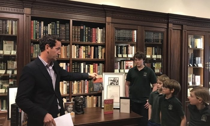 Store owner Matthew Raptis talks to Turtle River Montessori students about Dr. Martin Luther King Jr. and his importance on Monday at his bookstore on Worth Avenue in Palm Beach. Photo by Taylor Milano