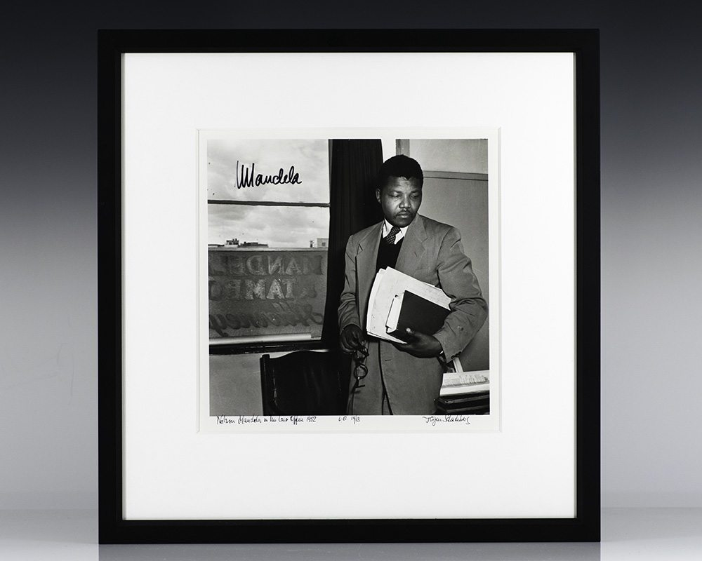 Silver Gelatin Print of Nelson Mandela in his law office in 1952;; signed by him and the photographer, Jurgen Schadeburg