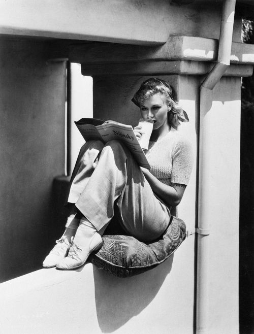Ginger Rogers reading a book