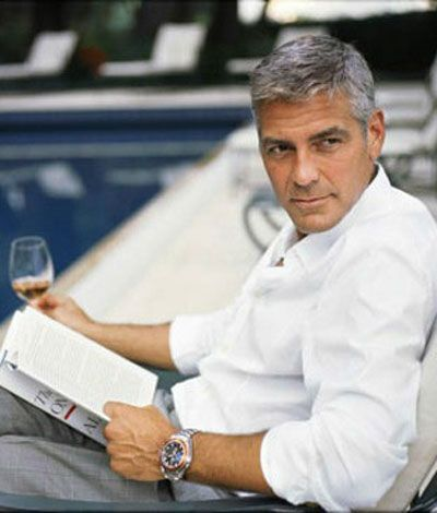 George Clooney reading books