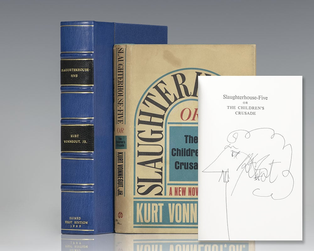 First edition of Slaughterhouse-Five; signed by Vonnegut with a self-caricature.