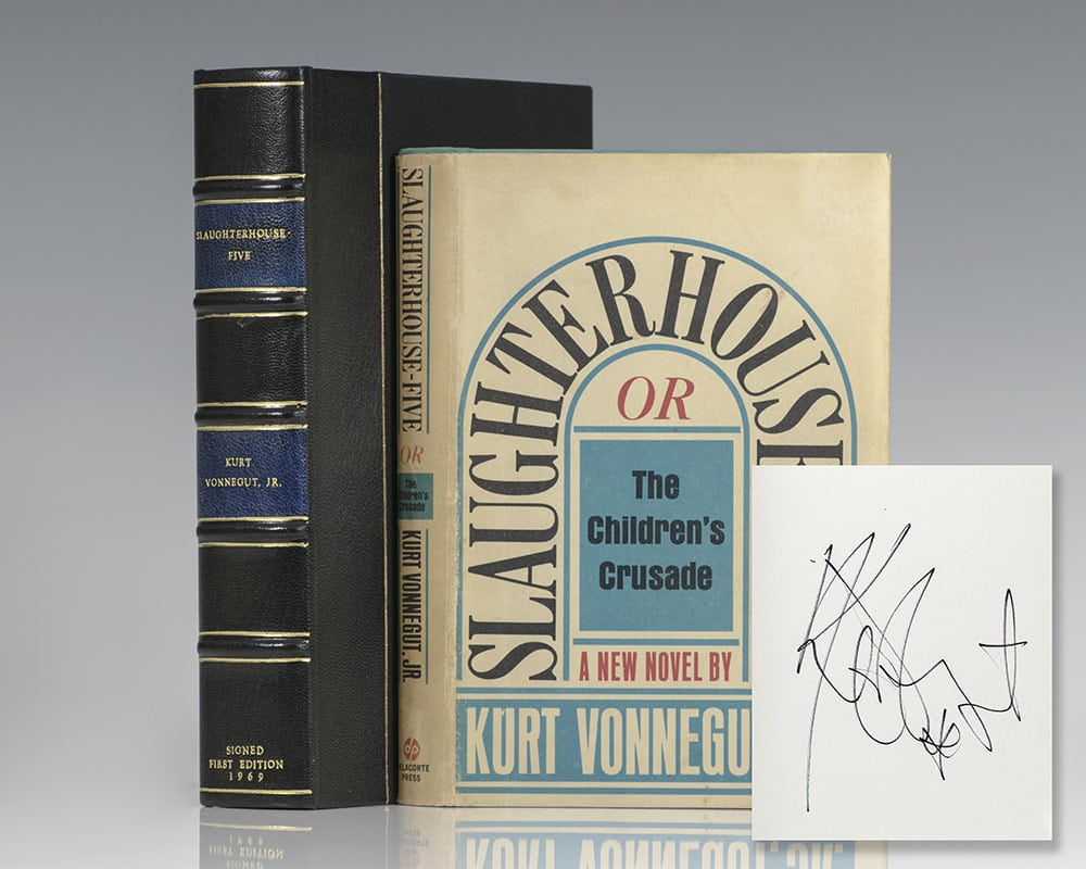 First edition of Vonnegut's masterpiece Slaughterhouse-Five; boldly signed by him on the half-title page.